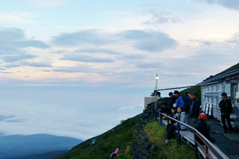 How much does it cost to climb Mount Fuji? 2 day trip to Mount Fuji from Tokyo: 7th station mountain hut Tomekan sunset. Backpacking Japan