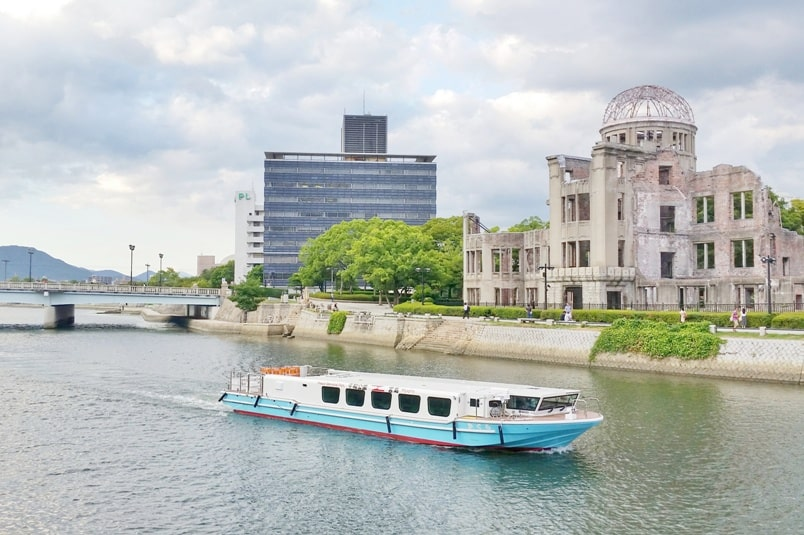 Hiroshima to Miyajima ferry with JR pass: Hiroshima peace memorial park ferry near atomic bomb dome. Backpacking Japan.