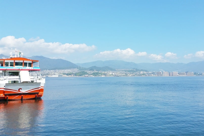 Hiroshima to Miyajima ferry with JR pass: JR ferry Miyajima station. Backpacking Japan.