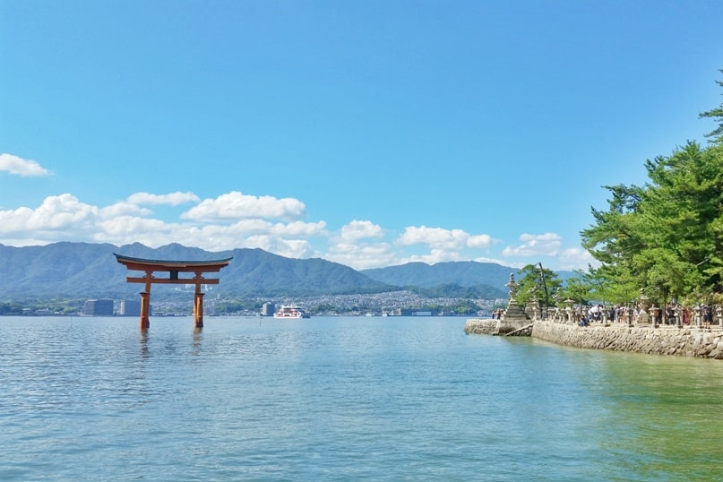 Osaka to Hiroshima shinkansen bullet train with JR pass. Hiroshima and Miyajima one day trip: Floating torii shrine gate at high tide. Backpacking Japan.