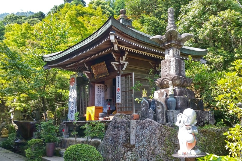 Best things to do on Miyajima Island in one day itinerary: Daisho-in Temple near Mount Misen hiking trail. Backpacking Japan.