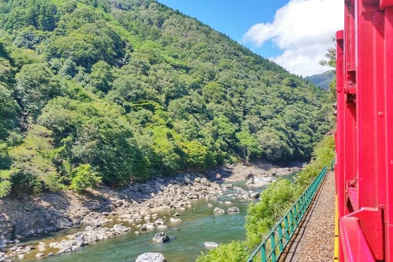 To Arashiyama torokko station on sagano scenic railway train aka sagano romantic train along hozugawa river. One day in Arashiyama Sagano. Backpacking Kyoto Japan