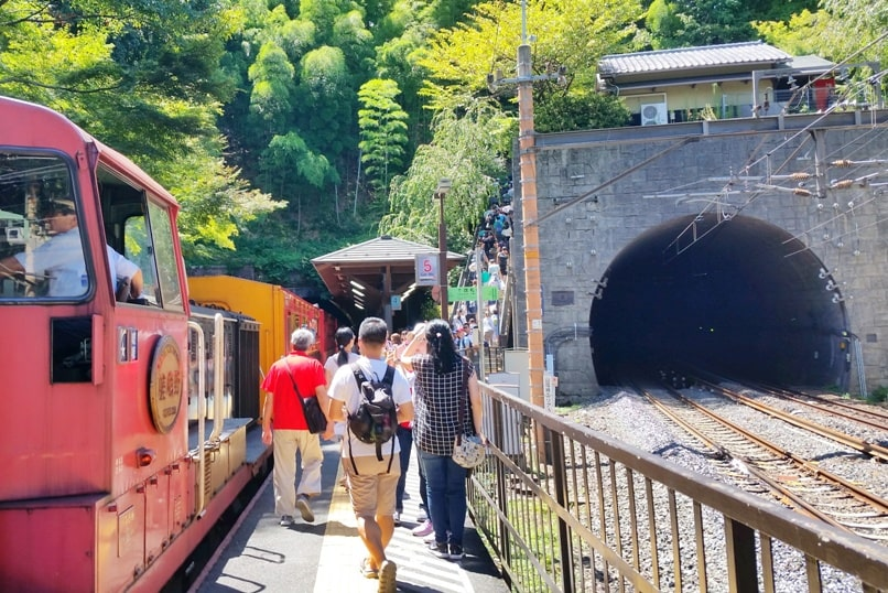 To Arashiyama torokko station on sagano scenic railway train. One day in Arashiyama Sagano. Backpacking Kyoto Japan