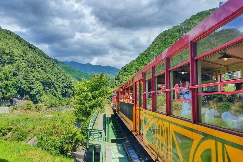 To Arashiyama torokko station on sagano scenic railway train aka sagano romantic train. One day in Arashiyama Sagano. Backpacking Kyoto Japan
