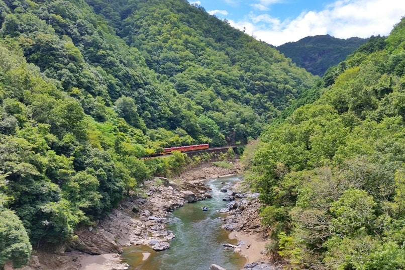 Hozukyo jr station with sagano scenic railway romantic train on hozugawa river with rafting or kayaking. One day in Arashiyama and Sagano. Backpacking Kyoto Japan