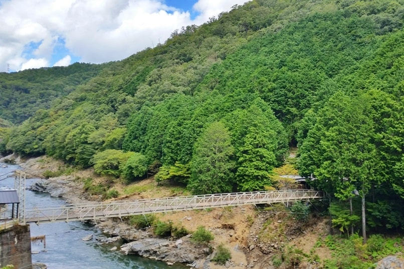 Hozukyo torokko station bridge over Hozugawa River. One day in Arashiyama and Sagano. Backpacking Kyoto Japan