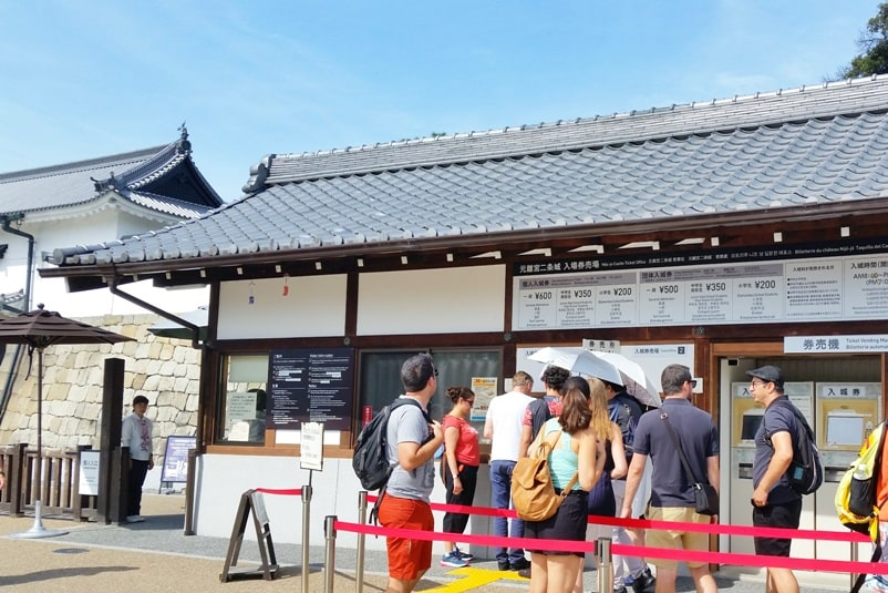 Visit to Nijo Castle. Buy admissions ticket to Nijo castle. Backpacking Kyoto Japan