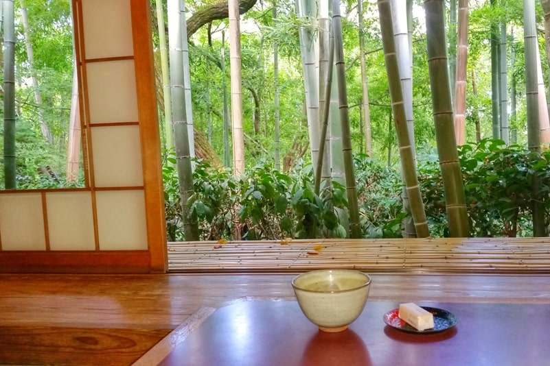 Okochi sanso villa garden teahouse visit next to bamboo grove forest with matcha green tea and Japanese sweets and snacks. One day in Arashiyama and Sagano. Backpacking Kyoto Japan