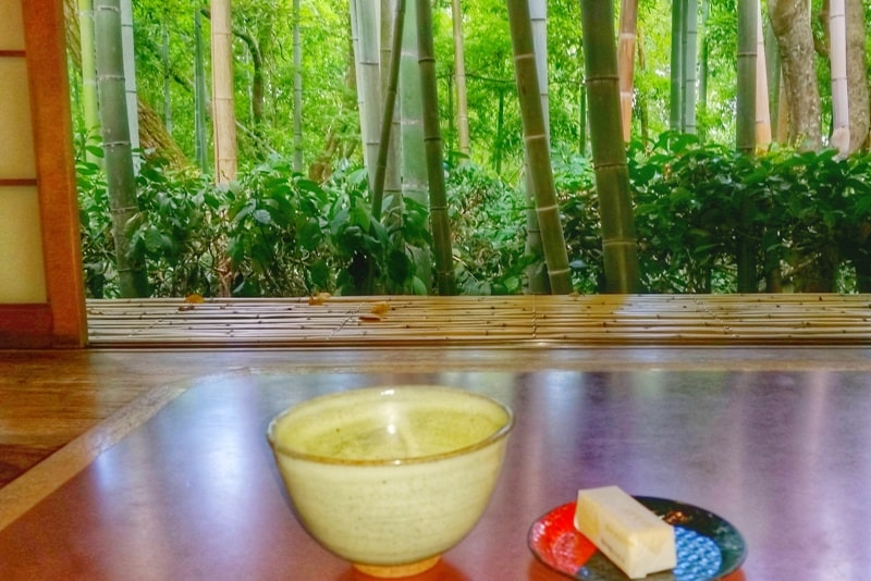Okochi sanso villa gardens teahouse with matcha green tea and Japanese snacks sweets next to bamboo grove forest. One day in Arashiyama Sagano. Backpacking Kyoto Japan