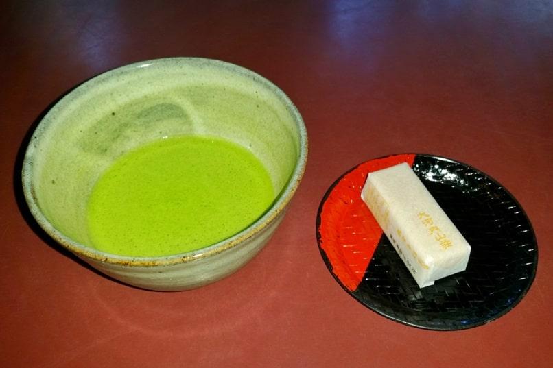 Okochi sanso villa gardens teahouse with matcha green tea and Japanese snacks sweets. One day in Arashiyama Sagano. Backpacking Kyoto Japan