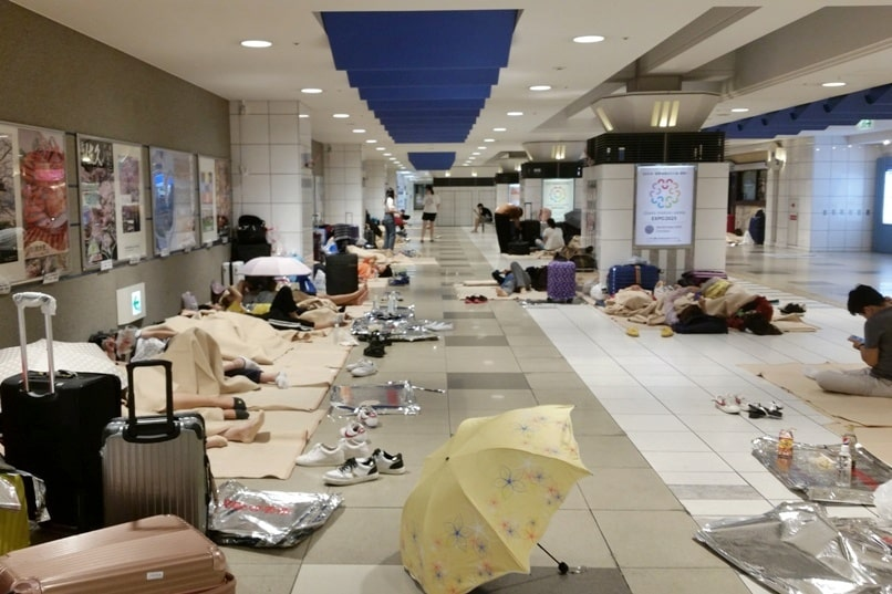 Travel insurance for Japan: Natural disaster coverage. Airport closed, flights canceled and delayed, sleeping with luggage, accommodation. Backpacking Japan Asia