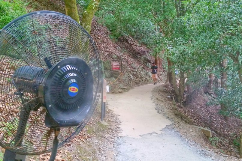 Arashiyama monkey park - Kyoto hike with misting fan on hiking trail on hot summer day in August. One day in Arashiyama and Sagano. Backpacking Japan