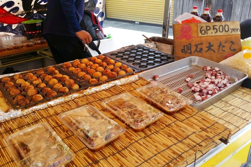 Fushimi inari to Ginkakuji - food near fushimi inari to train station walk - takoyaki octopus balls. Backpacking Kyoto Japan