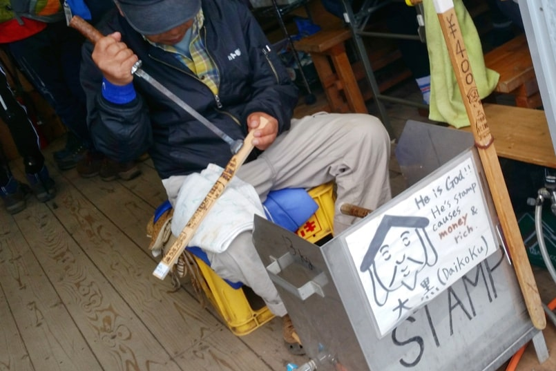 Mount fuji walking stick: stamp station at mountain huts. Climbing Mt Fuji. Hiking Japan
