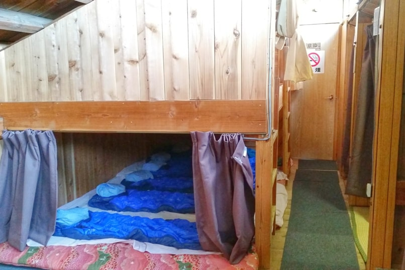 Mt Fuji mountain huts shared sleeping space with sleeping bag. Climbing Mount Fuji. Hiking in Japan.