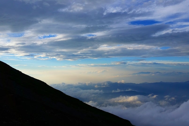 Mt Fuji mountain huts - sunset at 7th station mountain hut. Climbing Mount Fuji. Hiking in Japan.