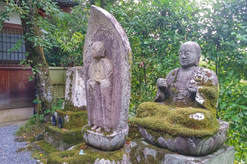 Philosopher's path walk - Eikando Temple visit - stone statue with moss garden. Backpacking Kyoto Japan