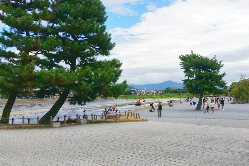 Togetsukyo bridge - Arashiyama park near bridge along Hozugawa river. One day in Arashiyama and Sagano. Backpacking Kyoto Japan