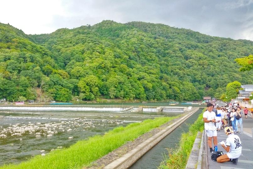 Togetsukyo bridge - Arashiyama streets near bridge along Hozugawa river. One day in Arashiyama and Sagano. Backpacking Kyoto Japan