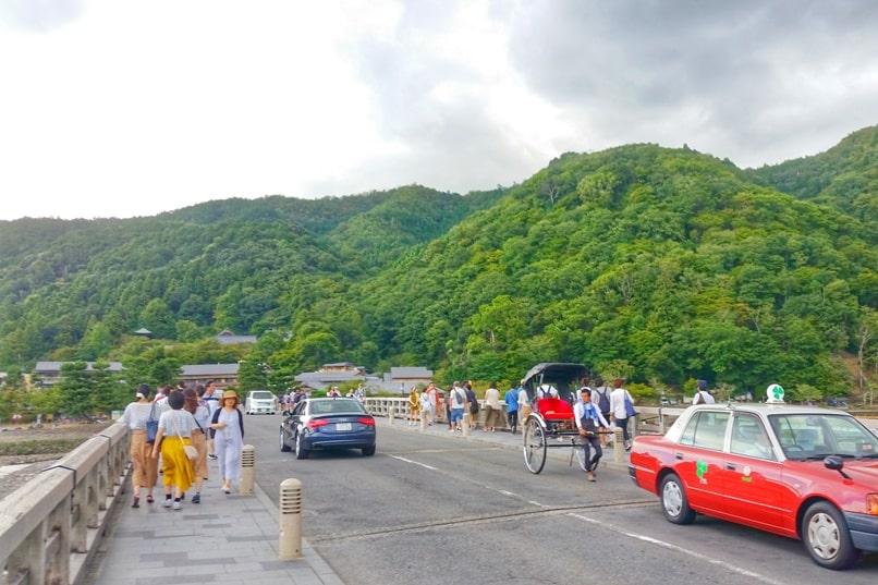 Walk across Togetsukyo bridge. Taxi in Arashiyama. One day in Arashiyama and Sagano. Backpacking Kyoto Japan
