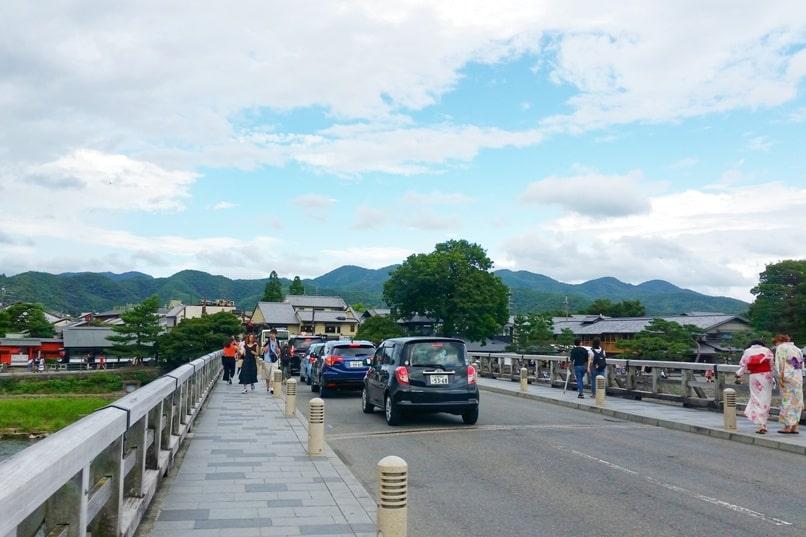 Walk across Togetsukyo bridge. Car traffic. One day in Arashiyama and Sagano. Backpacking Kyoto Japan
