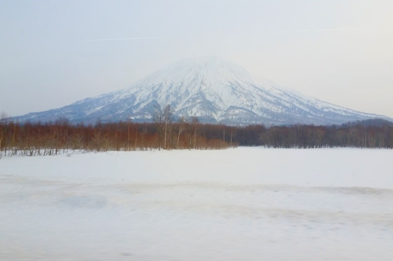 Sapporo Chitose Airport to Niseko bus ride with Mt Yotei views. Backpacking Hokkaido Japan winter ski and snowboarding
