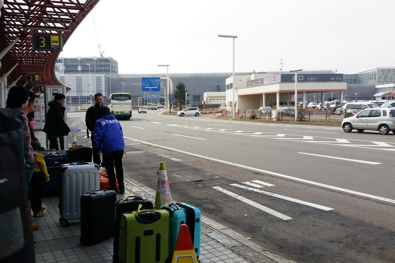 Sapporo Chitose Airport to Niseko bus platform. Backpacking Hokkaido Japan winter ski and snowboarding