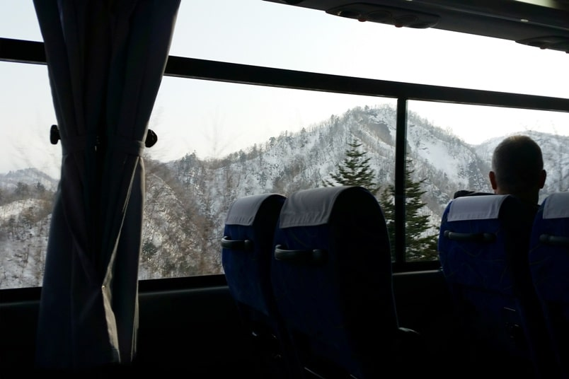Sapporo Chitose Airport to Niseko bus ride drive time. Backpacking Hokkaido Japan winter ski and snowboarding