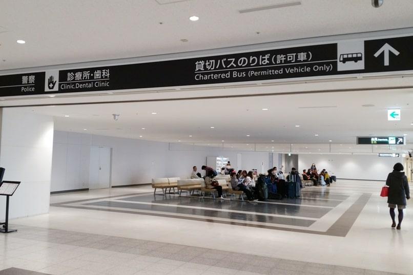 Sapporo Chitose Airport to Niseko bus waiting area to platform. Backpacking Hokkaido Japan winter ski and snowboarding