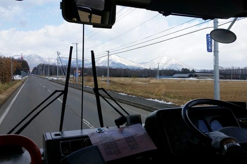 Sapporo to Lake Shikaribetsu igloo village: Rural Hokkaido roads on bus to Lake Shikaribetsu. Backpacking Hokkaido Japan winter