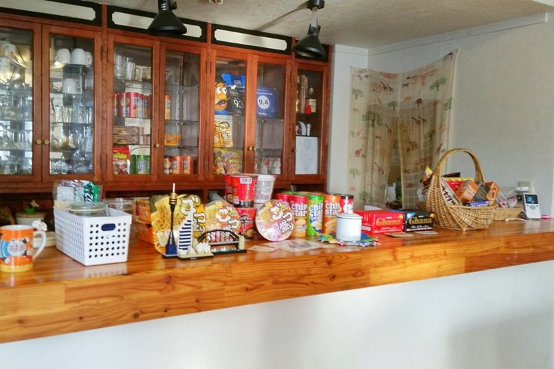 K's house hakuba hostel. common area with snacks. Backpacking Japan Alps winter travel