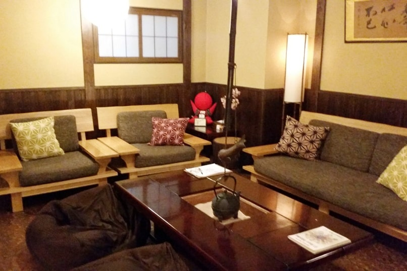 K's house Takayama hostel in hida valley. common area with hida mascot sarubobo. Backpacking Japan travel