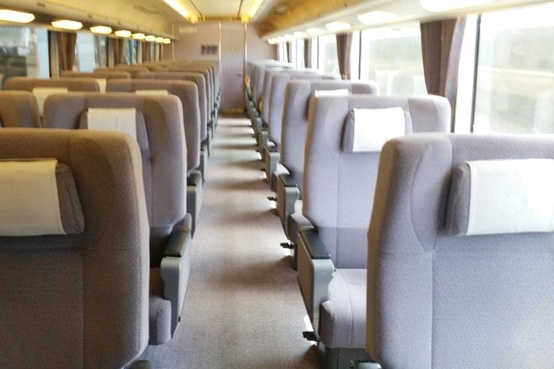 Kyoto to Kansai airport KIX train - jr haruka train green car seats from kyoto station to airport. Backpacking Kyoto Japan