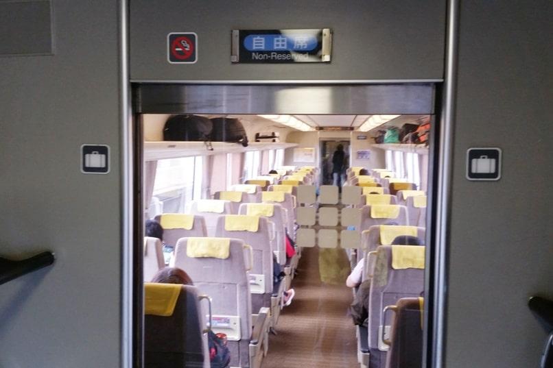 Kyoto to Kansai airport KIX train - jr haruka train non-reserved car seats from kyoto station to airport. Backpacking Kyoto Japan