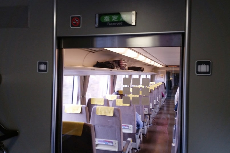 Kyoto to Kansai airport KIX train - jr haruka train reserved car seats from kyoto station to airport. Backpacking Kyoto Japan