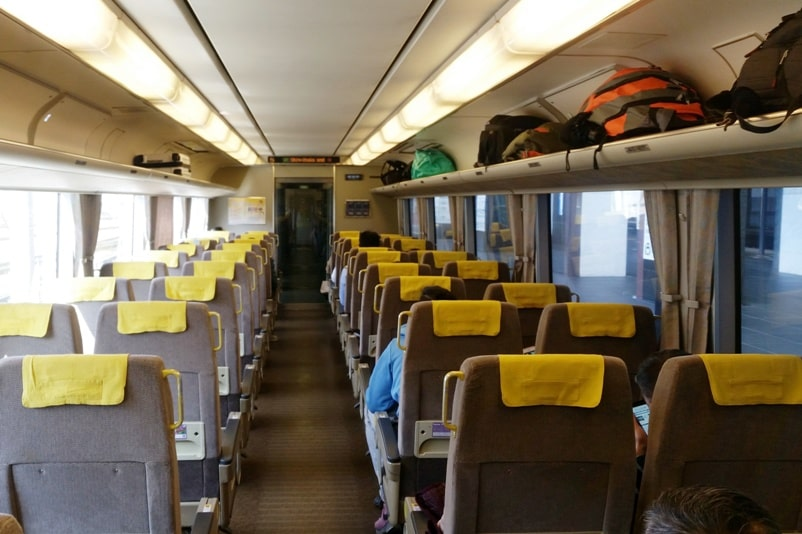 Kyoto to Kansai airport KIX train - jr haruka train reserved car seats (and non-reserved) from kyoto station to airport. Backpacking Kyoto Japan