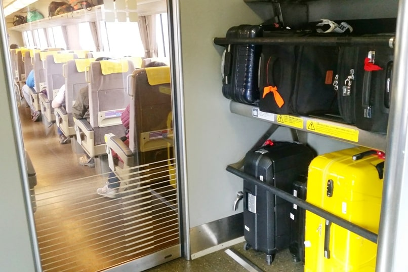 Kyoto to Kansai airport KIX train - jr haruka train luggage storage for suitcase or big backpack. Backpacking Kyoto Japan