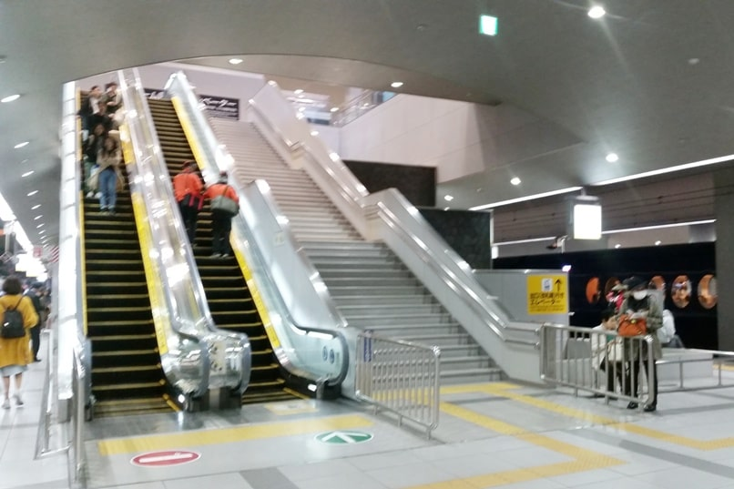 Kyoto to Kansai airport KIX train - escalators and stairs at airport. Backpacking Kyoto Japan