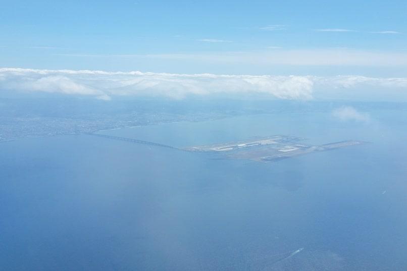 Kyoto to Kansai airport KIX train - flight from kansai airport man-made island. Backpacking Kyoto Japan