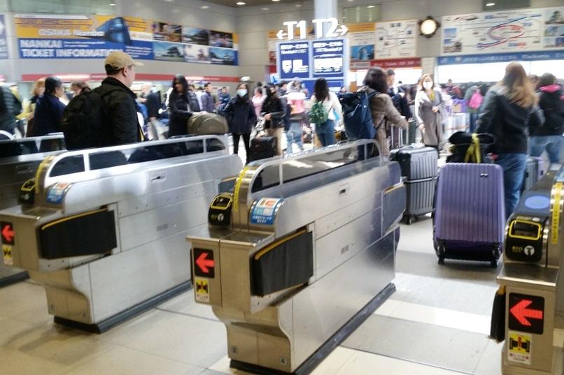 Kyoto to Kansai airport KIX train - ticket gate at airport train station. Backpacking Kyoto Japan
