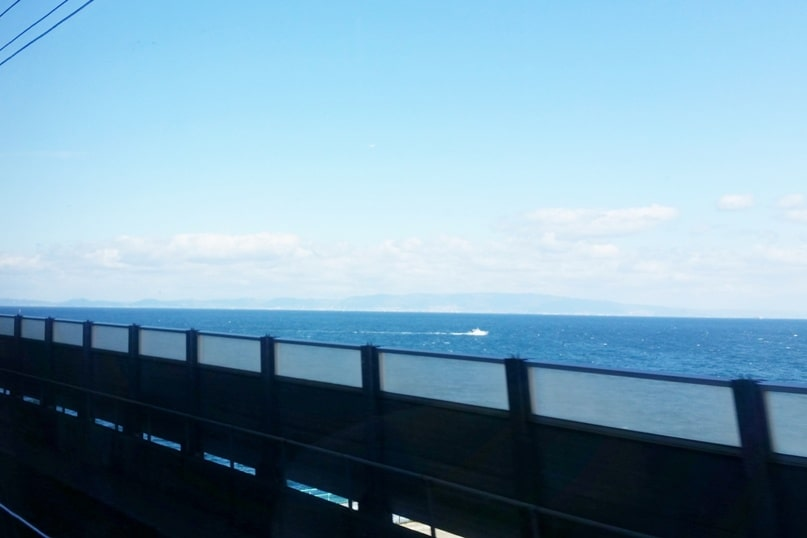 Kyoto to Kansai airport KIX train - jr haruka train ride bridge to man-made island airport. Backpacking Kyoto Japan
