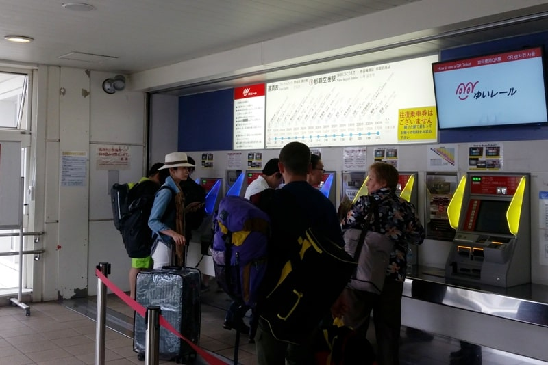 Okinawa monorail at Naha Airport - how to buy train tickets - ticket machines at ticket gates. Backpacking Okinawa Japan