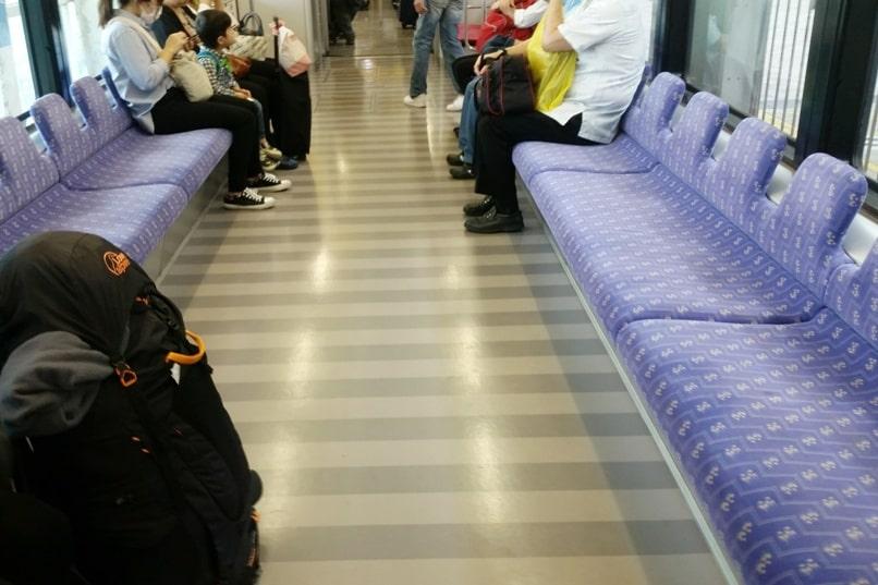 Okinawa monorail at Naha Airport - yui rail train seats with luggage. Backpacking Okinawa Japan