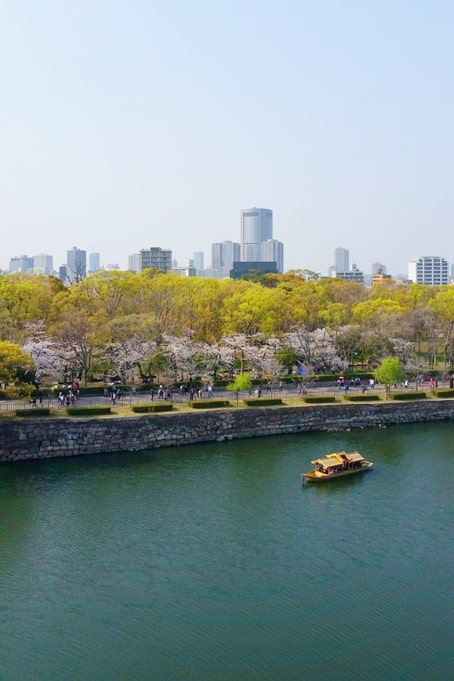 Osaka castle gozabune boat ride along osaka castle park with cherry blossoms - cost how much - things to do in osaka to see cherry blossoms. Backpacking Osaka Japan