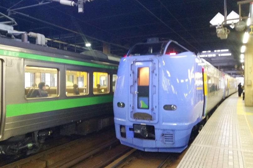 Sapporo to Asahikawa train - limited express JR train - soya or lilac or okhotsk. Sapporo train station. Backpacking Hokkaido Japan