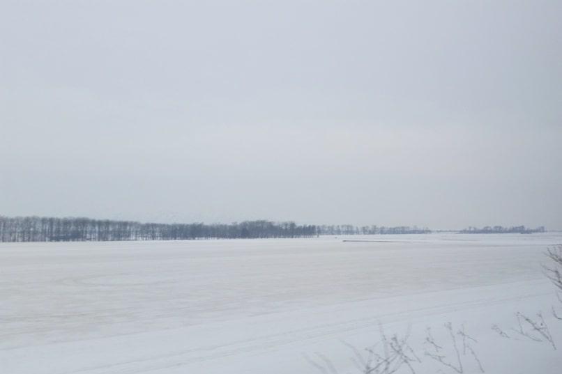 Sapporo to Asahikawa train ride along in winter. Backpacking Hokkaido Japan
