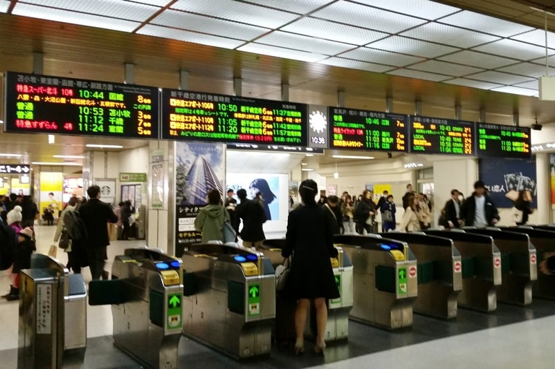Sapporo to Asahikawa train. Sapporo station train ticket gate. Backpacking Hokkaido Japan