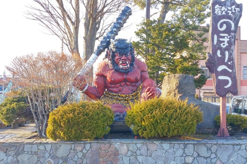 Sapporo to Noboribetsu. Noboribetsu train station. Day trip to Noboribetsu onsen and jigokudani hell valley, demon statues. Backpacking Hokkaido Japan