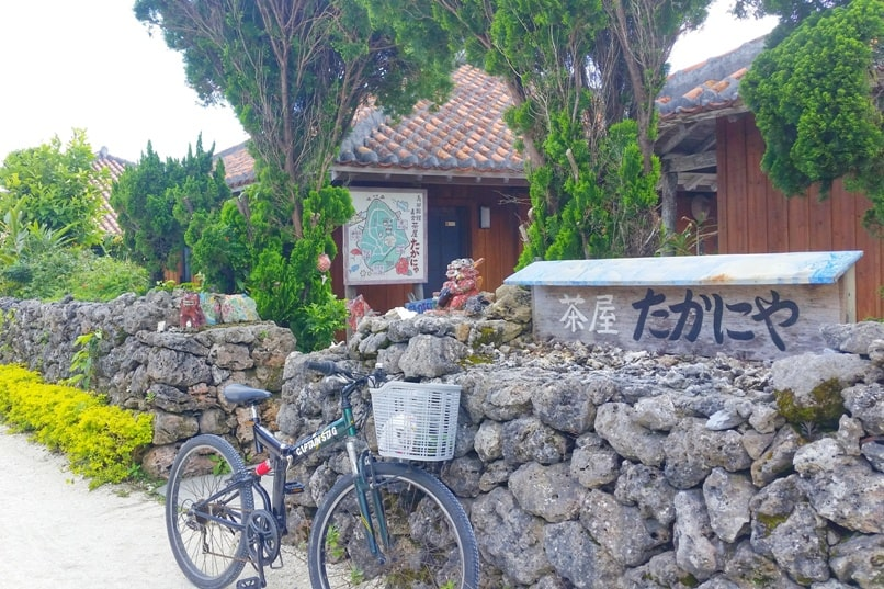 Taketomi Island - cycling Taketomi village streets. Backpacking Yaeyama islands, Okinawa Japan