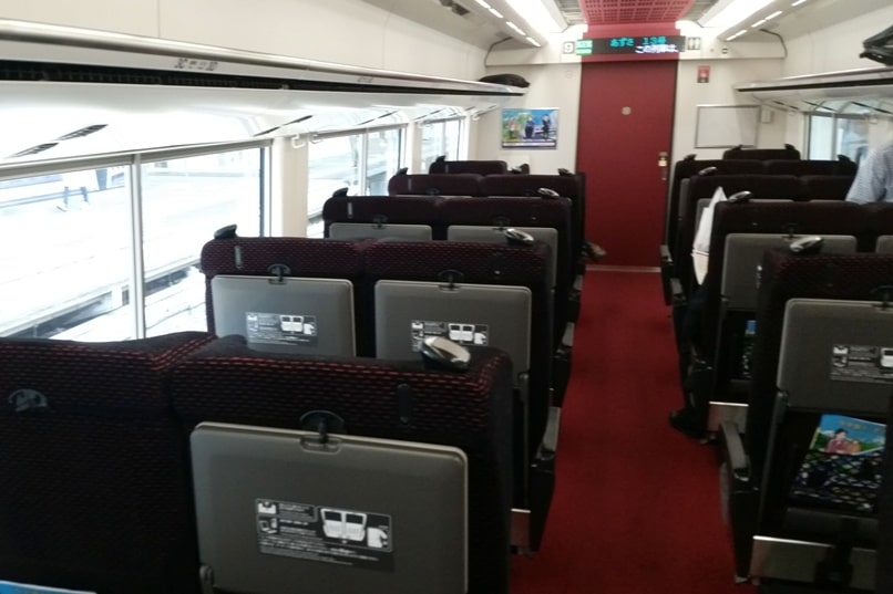 Tokyo to Chureito Pagoda. JR Azusa limited express train green car seats interior. Backpacking Tokyo Japan